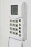 Security system console. Mounted on a wall, shallow DOF Royalty Free Stock Photo