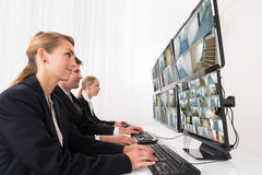 Security System Operators Looking At CCTV Footage Stock Photo