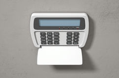 Security System Panel. A 3D render of a home security keypad access panel with buttons and a blank illuminated screen mounted on a wall Stock Photos
