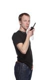 Security talking through his walkie talkie. Royalty Free Stock Image