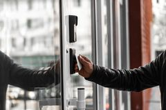 Security technologies, security systems, electronic keys, motion sensors. Hands open the door stock images