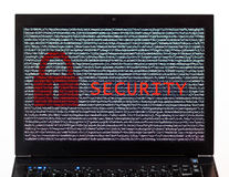 Security text with red lock over encrypted text on a laptop scre. En against a white background - cyber crime Royalty Free Stock Photos