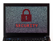 Security text with red lock over encrypted text on a laptop scre. En against a white background - cyber crime Royalty Free Stock Image