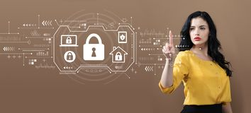 Security theme with business woman. On a brown background royalty free stock photography