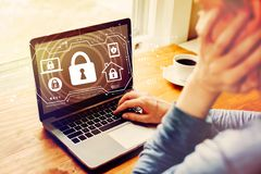 Security theme with man using a laptop royalty free stock images