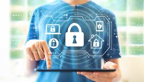 Security theme with man using a tablet stock images