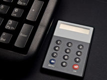 Security token and keyboard. Security token for on line banking near a keyboard Royalty Free Stock Image