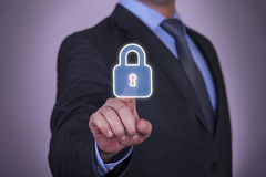 Security Touch Screen Finger Pointing to Padlock Icon Stock Photos