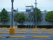 Security Tower in Valet Parking Lot. Texas is big and thinks big, but this valet parking lot is even bigger. The security tower looks over acres of parking at a Royalty Free Stock Photography