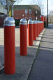 Security traffic bollards. A row of steel security bollards used to protect buildings from threats by terrorism or crime Royalty Free Stock Photos