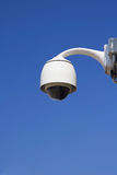 Security video camera. Security video camera against blue sky stock photos