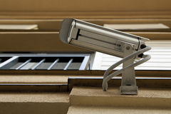 Security video camera. On the wall Stock Photos