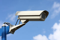 Security video camera. On background blue sky Stock Photos