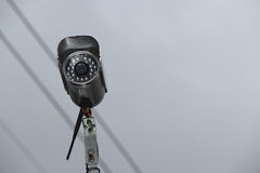 Security video camera in the sky Royalty Free Stock Image
