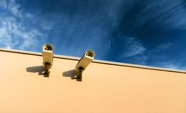 Security video cameras. On a wall Royalty Free Stock Photo