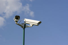 Security video cameras. Above the sky Royalty Free Stock Images