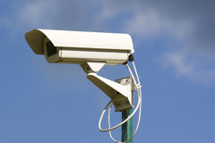 Security video cameras. Above the sky Stock Photography