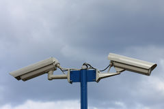 Security video cameras. On background blue sky Stock Photos