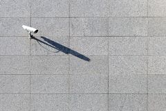 Security video surveillance camera at marble wall background. minimalism stock image