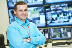 Security video surveillance chief. Security executive chief in front of video monitoring surveillance security system stock photography
