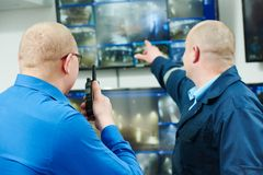 Security video surveillance. Security executive chief discussing activity with worker in front of video monitoring surveillance security system stock photos