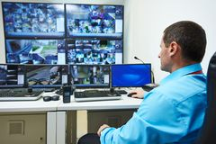 Security video surveillance. Security guard watching video monitoring surveillance security system royalty free stock photo