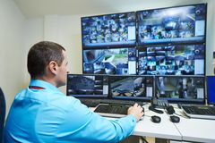 Security video surveillance. Security guard watching video monitoring surveillance security system stock photo