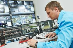 Security video surveillance. Security guard watching video monitoring surveillance security system stock images