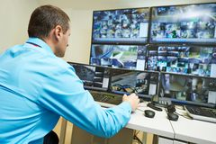 Security video surveillance. Security guard watching video monitoring surveillance security system royalty free stock image