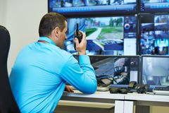 Security video surveillance. Security guard watching video monitoring surveillance security system stock photos