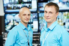 Security video surveillance team. Security guarв workers team in front of video monitoring surveillance security system Royalty Free Stock Images