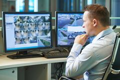 Free Security Worker During Monitoring. Video Surveillance System. Stock Photo - 171363810