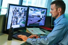 Security worker during monitoring. Video surveillance system. Video surveillance system. Security guard man monitoring objects Stock Images