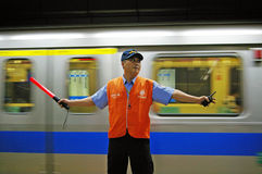 Security worker in Taiwan train station Stock Photo