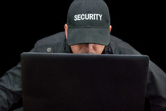 Security Working On Laptop, Brim Down. Close-up of security working on a laptop, brim down royalty free stock photography