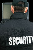 Security Working On Laptop, Over The Shoulder Stock Photo