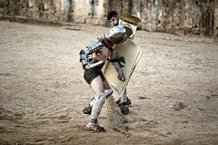 Secutor gladiator pushing Royalty Free Stock Photography