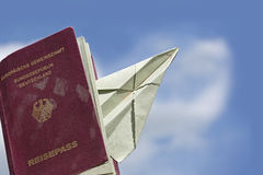 Sed passport from Germany with a paper airplane against the blue Royalty Free Stock Photo