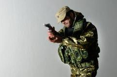 Seda realística diminuta do boneco de ação do soldado do homem do brinquedo Foto de Stock