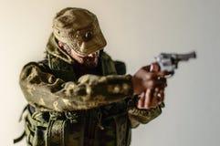 Seda realística diminuta do boneco de ação do soldado do homem do brinquedo Fotografia de Stock Royalty Free