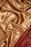Seda roja del oro con la esquina roja Foto de archivo libre de regalías