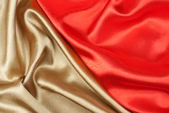 Seda roja y de oro Fotos de archivo libres de regalías