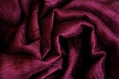 Seda rojo oscuro como fondo abstracto Imagen de archivo