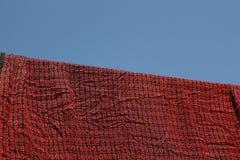 Seda tailandesa con el fondo del cielo azul Fotografía de archivo libre de regalías