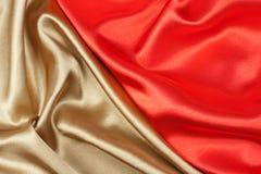 Seda vermelha e dourada Fotos de Stock Royalty Free