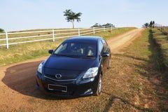 Sedan car on country road Royalty Free Stock Image
