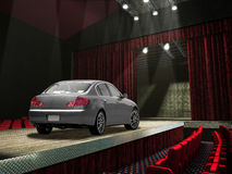 Sedan car on a fashion runway, in the spotlght. Royalty Free Stock Photos