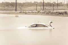 Swamp car flood. Sedan car swamped by flood water in East Houston, Texas, US by Harvey Tropical Storm. Submerged car on deep heavy high water road. Disaster Royalty Free Stock Photos