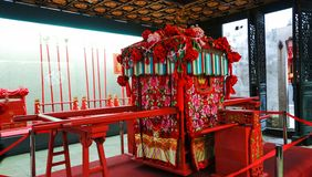 Sedan chair. One kind of rely on people or animals carry, load line for people to take public transport. Its structure, the chair is mounted on a moveable bed Stock Images