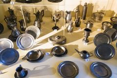 Pewter dishes in museum of Chateau de Sedan. SEDAN, FRANCE - JUNE 30, 2010: pewter dishes in museum of castle Chateau de Sedan. Sedan is a commune in Ardennes stock image